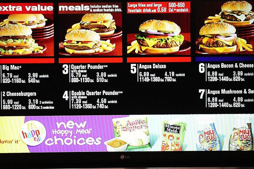 McDonald's Corp in January will cut eight food items and reduce the number of so-called Extra Value Meals on its US menus in a bid to speed up service and bolster sales, said Mike Andres, the company's US president. -- PHOTO: AFP