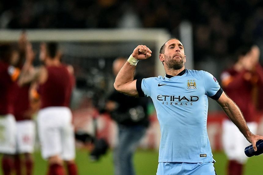 Manchester City's Argentinian defender Pablo Zabaleta celebrates after scoring during the UEFA Champions League football match AS Roma vs Manchester City at the Olympic stadium in Rome on Dec 10, 2014. -- PHOTO: AFP