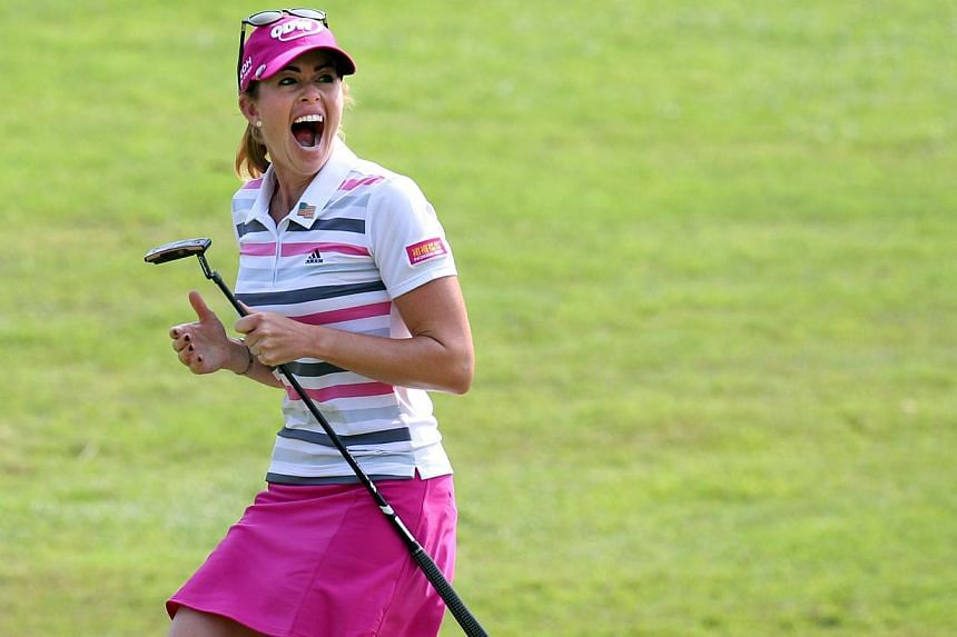 American golfer Paula Creamer celebrates after sinking an eagle to win the HSBC Women's Champions at Sentosa Golf Club on March 2, 2014. -- PHOTO: ST FILE