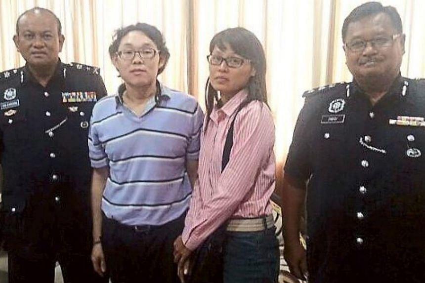 (From left) Sabah CID chief SAC Salehudin Abdul Rahman, former hostage Chan Sai Chuin, his wife Chin Pek Nyen and Sandakan police chief ACP Zabidi Zain. -- PHOTO: THE STAR/ASIA NEWS NETWORK
