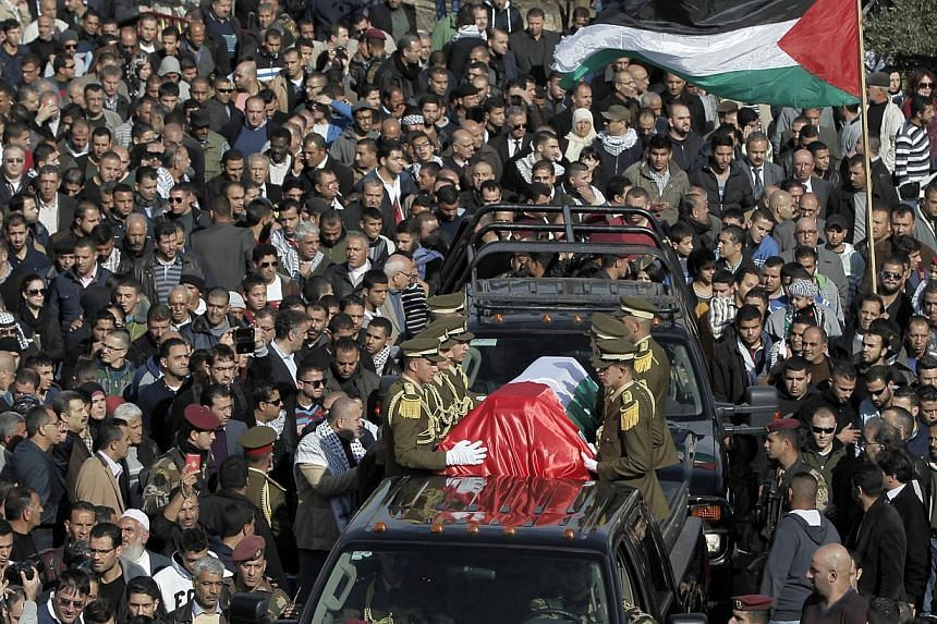 Palestinian security members drive with the coffin of senior Palestinian official Ziad Abu Ein during his funeral in the West Bank city of Ramallah on Dec 11, 2014.-- PHOTO: AFP