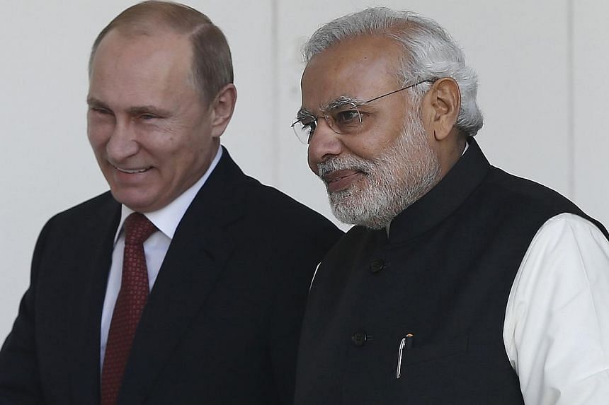 Russian President Vladimir Putin (left) and India's Prime Minister Narendra Modi arrives for a photo opportunity ahead of their meeting at Hyderabad House in New Delhi, India on Dec 11, 2014. -- PHOTO: REUTERS
