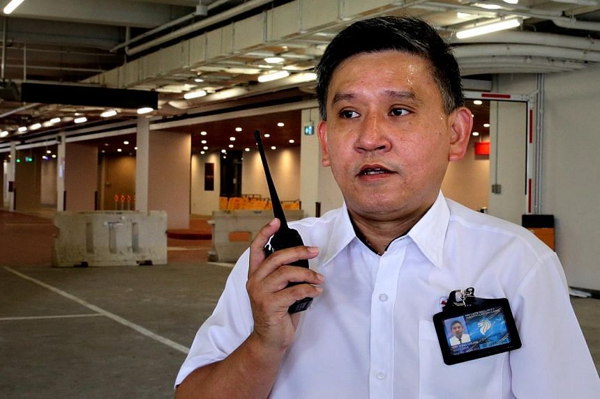 The Straits Times' manpower correspondent Toh Yong Chuan working undercover as a security guard. -- ST PHOTO: CHEW SENG KIM