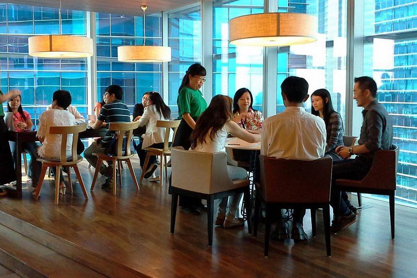 "Tea servers or ""tea-ristas"" guide customers through the ""Hush"" tea ritual. Social enterprise Hush hopes to get busy people to slow down and embrace silence. -- PHOTO: HUSH"