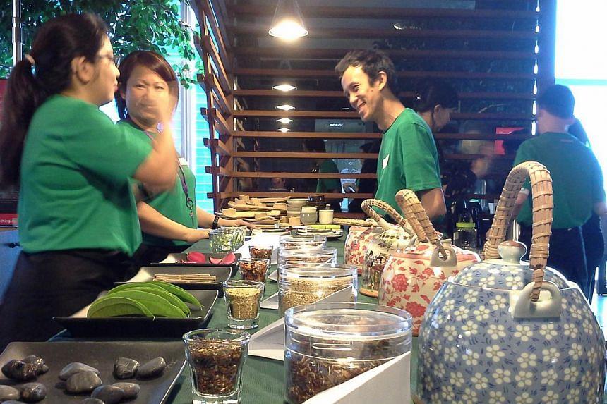 Tea servers of social enterprise, Hush, prepare for a tea ritual. Hush hopes to get busy people to slow down and embrace silence. -- PHOTO: HUSH
