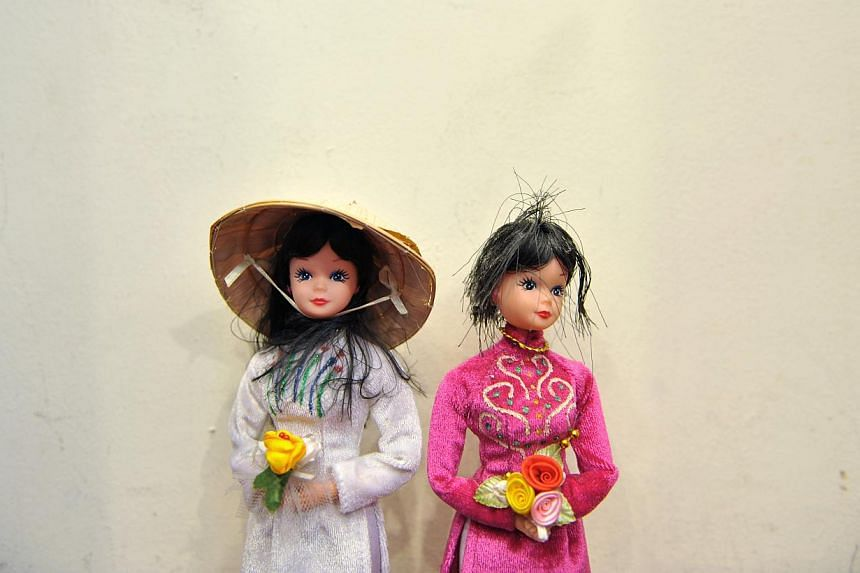 A couple of vietnamese dolls at a vietnamese bride agency. The Chinese police are seeking more than 100 Vietnamese brides who vanished after marrying bachelors from a poor rural area. -- PHOTO: ST FILE