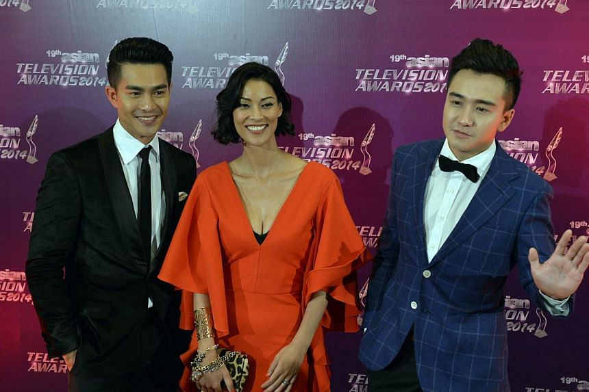 Actor Pierre Png (left), who won the Best Actor Award for his role in TV drama Zero Calling. -- ST PHOTO: DESMOND FOO
