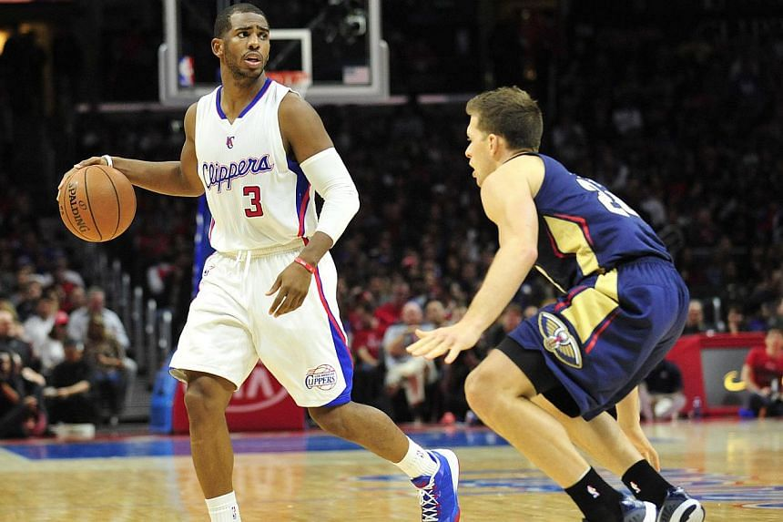 Chris Paul (left) scored 17 points and 15 assists to lead the Los Angeles Clippers to their ninth straight win with a 103-96 victory over the struggling Indiana Pacers Wednesday. -- PHOTO: GARY A VASQUEZ-USA TODAY SPORTS