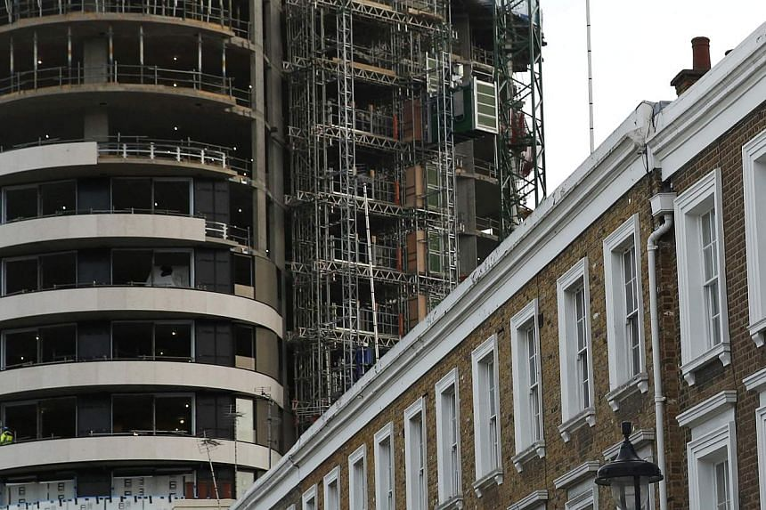 An apartment block under construction behind a row of traditional properties in central London on Dec 11, 2014. A British housing crash is among the 10 extreme scenarios that could become reality next year and turn global markets upside down, Saxo Ba