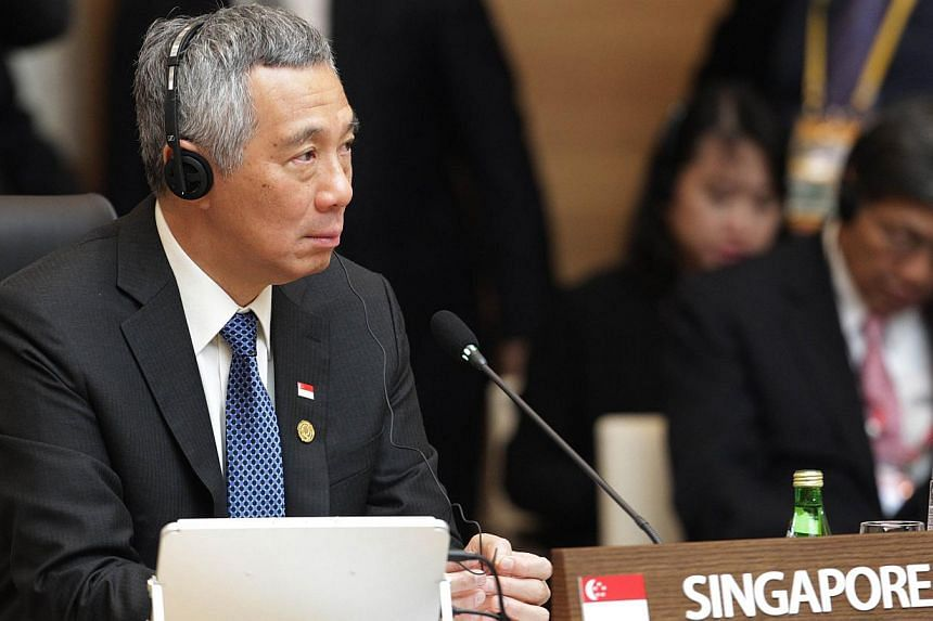 Prime Minister Lee Hsien Loong attends the formal session of the Asean-Republic of Korea Commemorative Summit in Busan on Dec 12, 2014. -- PHOTO: AFP