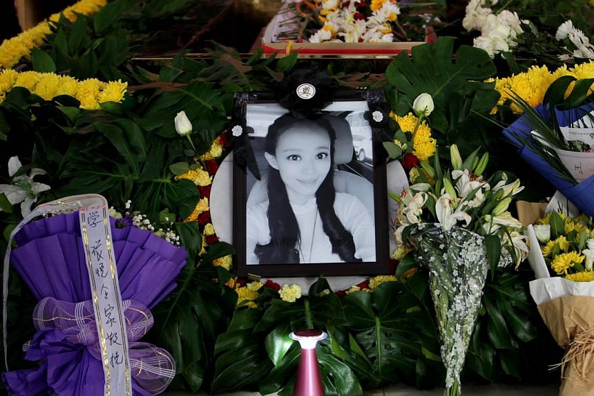 A photo of Qiu Yuanyuan, a Chinese television presenter who died of cancer, is displayed during her funeral ceremony in Zhengzhou, north China's Henan province on Dec 12, 2014. -- PHOTO: AFP