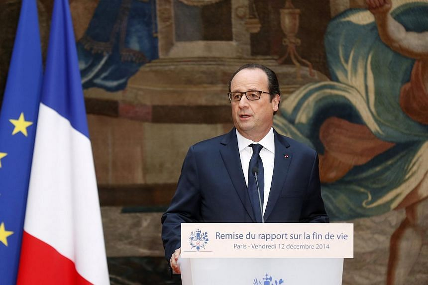 French President Francois Hollande delivers his speech about reform of end-of-life treatment at the Elysee Palace in Paris on Dec 12, 2014.French lawmakers unveiled proposals Friday for a bill that would allow doctors to plunge terminally-ill p