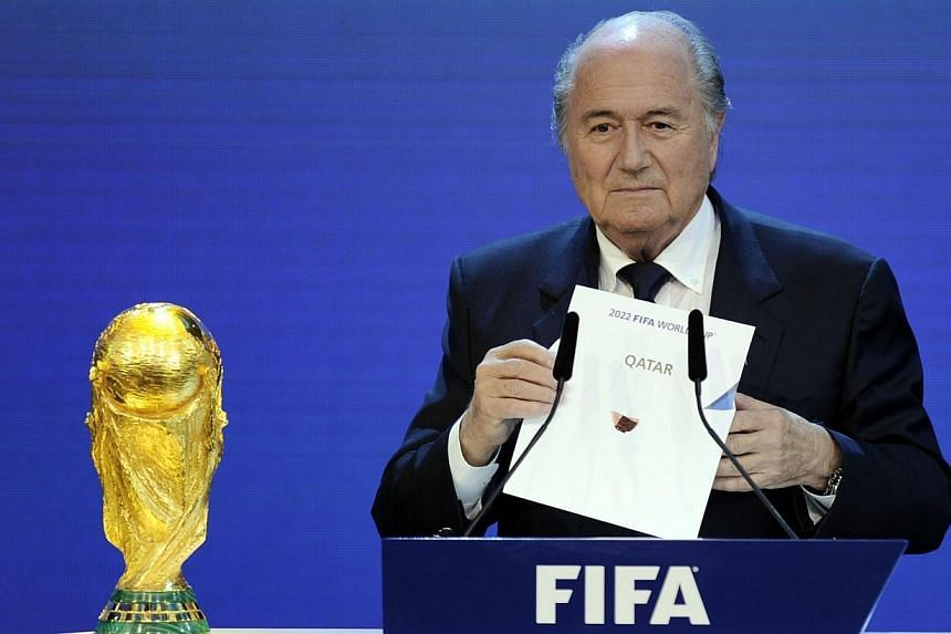 FIFA President Sepp Blatter holding up the name of Qatar during the official announcement of the 2022 World Cup host country at the FIFA headquarters in Zurich on Dec 2, 2010. Swiss lawmakers on Friday approved a bill to increase the financial s