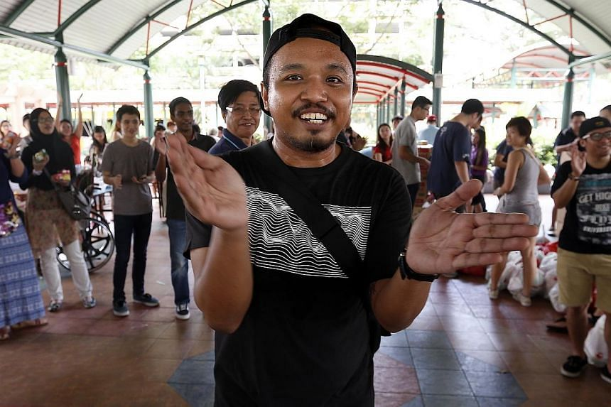 First-aid trainer Mohammed Nafiz Kamarudin, 33, holds parties for elderly cardboard collectors once every two to three months. He is one of founders of Happy People Helping People Foundation, an informal, non-profit organisation. -- ST PHOTO: LAU FOO