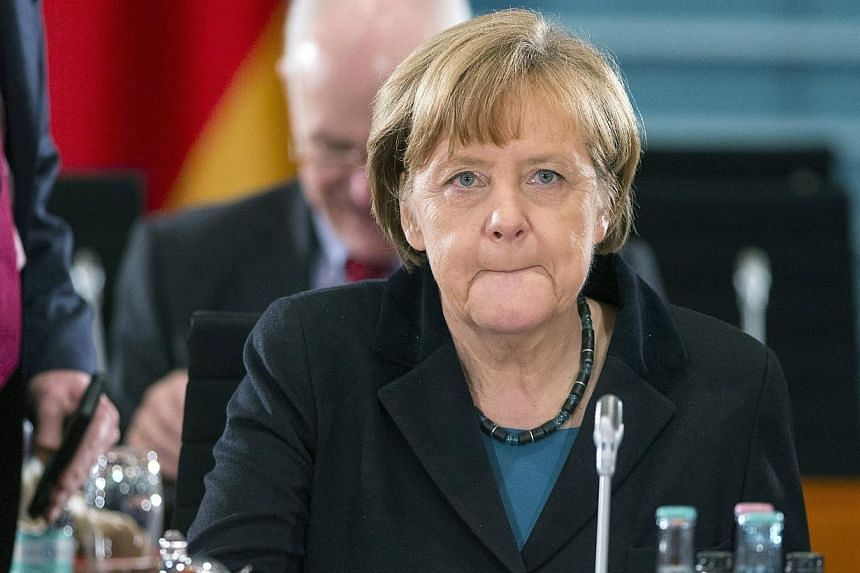 German Chancellor Angela Merkel meets German state leaders at the chancellery in Berlin on Dec 11, 2014. -- PHOTO: REUTERS