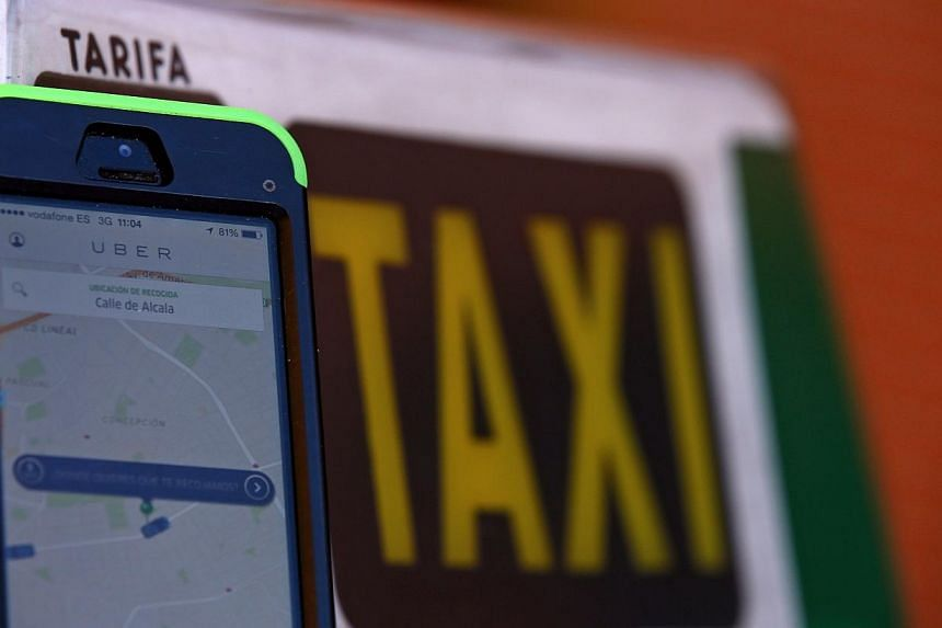 Top Chinese search engine Baidu will make a strategic investment of up to US$600 million (S$750.18 million) in the popular but controversial US taxi app Uber, state media said Friday. -- PHOTO: REUTERS