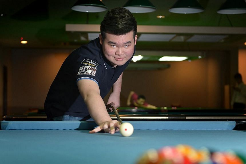 Aloysius Yapp made history last month when he became the first Singapore-born pool player to win a world title. -- PHOTO: ST FILE