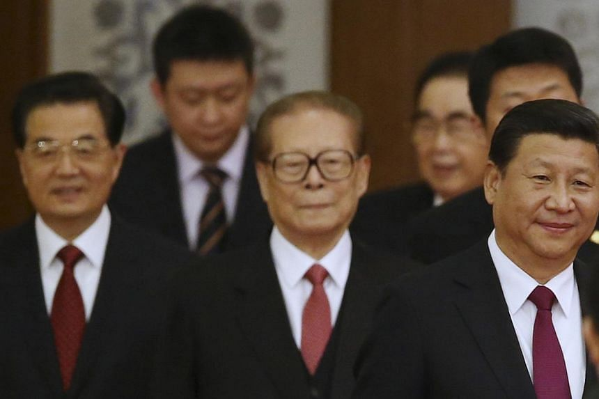 China's President Xi Jinping (right) walks with retired leaders Jiang Zemin (centre) and Hu Jintao (left) as they arrive at the National Day Reception to mark the 65th anniversary of the founding of People's Republic of China, at the Great Hall of th