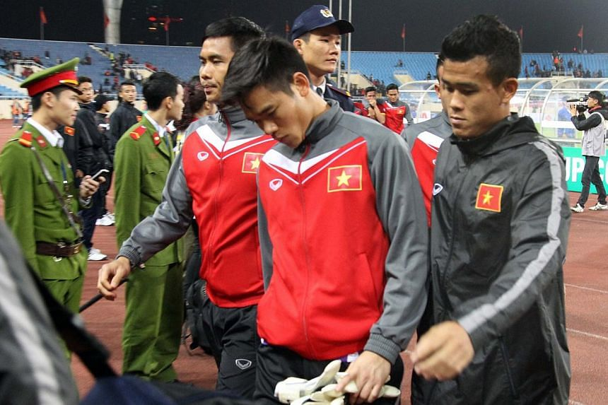 Vietnam's players react after Vietnam was defeated by Malaysia in the semi-final AFF Suzuki Cup return match at Hanoi's My Dinh stadium on Dec 11, 2014.Vietnam's football authorities will investigate the country's team for suspected foul play a