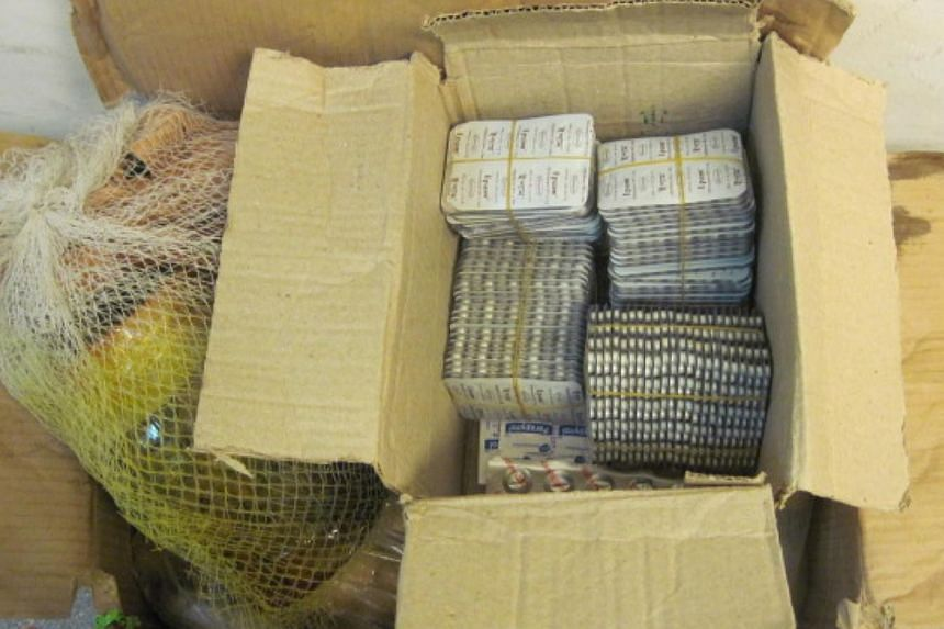 A total of 3,520 sleeping pills were seized from a male Bangladesh national at Changi Airport on Thursday. -- PHOTO: ICA