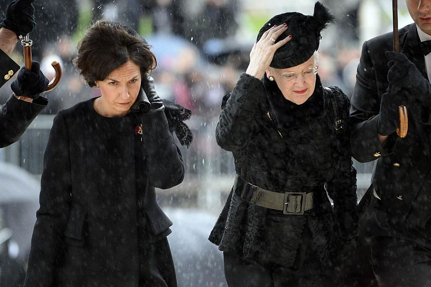 Queen Margrethe of Denmark (right) arrives for the funeral of the late Belgium queen dowager Fabiola at the Saint Michael and Saint Gudula cathedral in Brussels, on Dec 12, 2014. -- PHOTO: AFP/BELGA