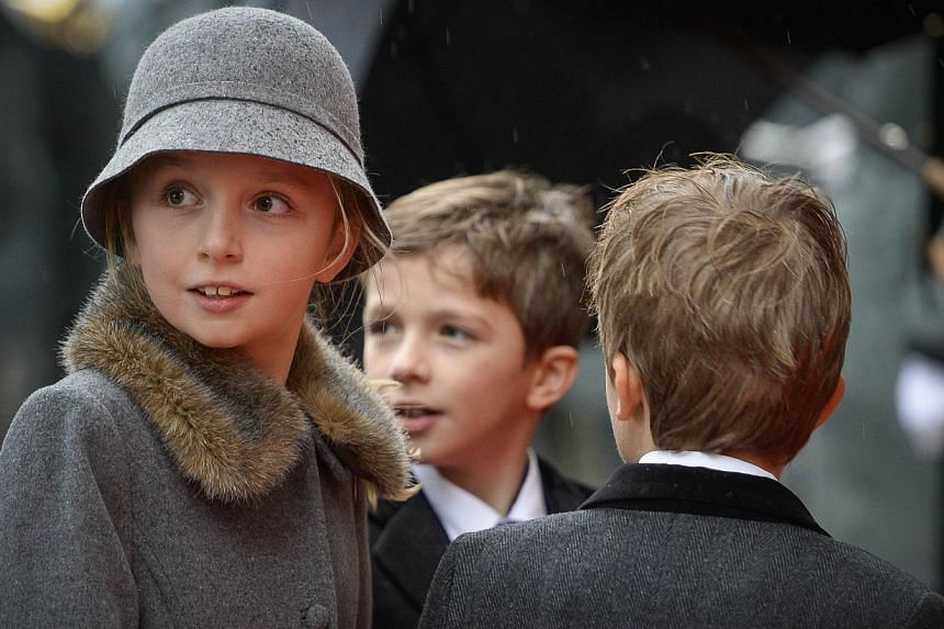 (From left) Princess Louise, Prince Aymeric and Prince Nicolas of Belgium arrive at the Saint Michael and Saint Gudula cathedral in Brussels, on Dec 12, 2014, for the funeral of late Queen Fabiola of Begium. -- PHOTO: AFP/BELGA