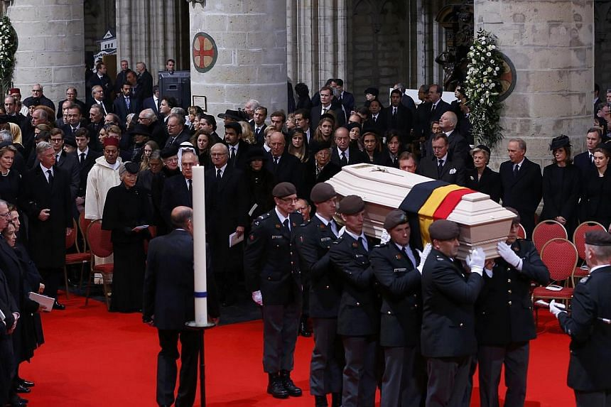Pallbearers carry the coffin of Belgium's Queen Fabiola during a funeral service at Saint Michael and Saint Gudula cathedral in Brussels on Dec 12, 2014. -- PHOTO: REUTERS