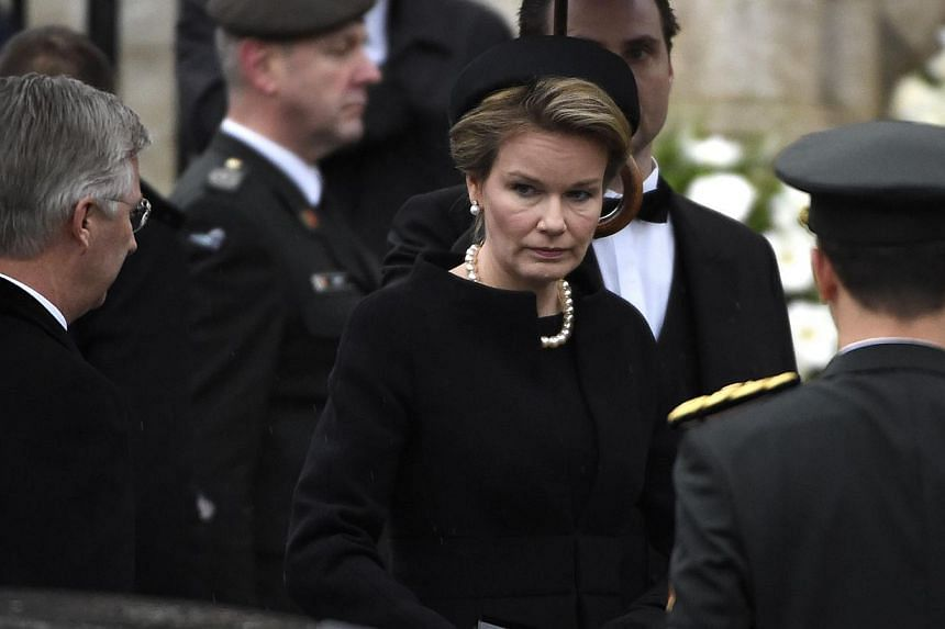 King Philippe of Belgium (left) and Queen Mathilde of Belgium (centre) arrive for the funeral service of the late queen dowager Fabiola, at the Cathedral of St Michael and St Gudula in Brussels, on Dec 12, 2014. -- PHOTO: AFP