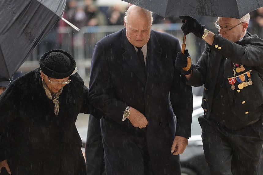 Princess Astrid of Norway (left) and King Harald V (centre) of Norway arrive at the Saint Michael and Saint Gudula cathedral in Brussels, on Dec 12, 2014, for the funeral of late Queen Fabiola of Begium. -- PHOTO: AFP/BELGA
