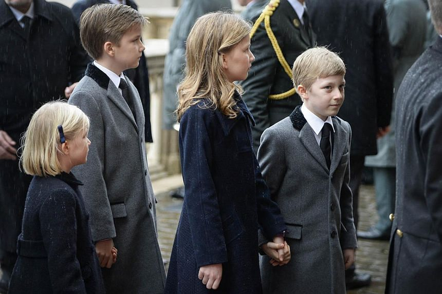 (From left) Princess Eleonore, Prince Gabriel, Crown Princess Elisabeth and Prince Emmanuel of Belgium arrive at the Saint Michael and Saint Gudula cathedral in Brussels, on Dec 12, 2014, for the funeral of late Queen Fabiola of Begium. -- PHOTO: AFP