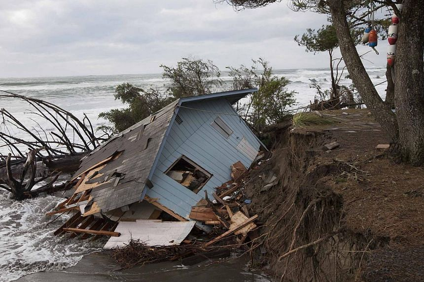A home sits off of its foundation in Washaway Beach, Washington on Dec 11, 2014, as a Pacific winter storm hits the western United States. A major storm that pummeled northern California and the Pacific Northwest with heavy rain and high winds a
