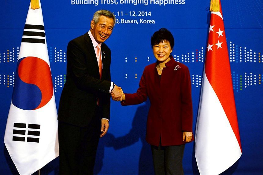 (Left) Prime Minister Lee Hsien Loong and South Korean President Park Geun Hye reaffirmed ties and expressed hope for further collaboration, such as in trade and air links. Mr Lee says both countries can benefit even more from a boost to their 2006 b