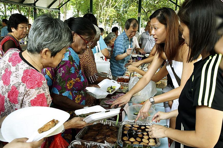 Beneficiaries and volunteers at an Extend the Feast event in Toa Payoh organised by the Happy People Helping People Foundation last month. The non-profit group has organised five such events in the past year and each one draws at least 100 elderly be