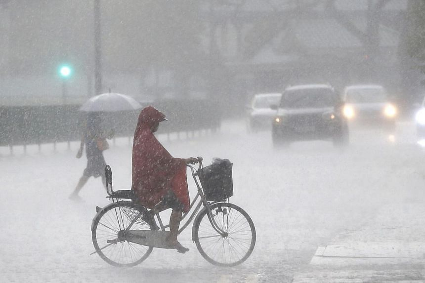 """Braving the downpour in Toa Payoh last month. Is the increasing frequency of extreme or weird weather events in Singapore and elsewhere due to climate change? Unfortunately the answer is not a straightforward """"yes"""" or """"no"""", and requires a nuanced exp"""