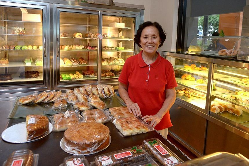 Madam Mary Chiam (left), 72, helps out at family business Balmoral Bakery on a part-time basis. For Chin Huat Live Seafood (right), which has been in Sunset Way since the 1980s, the relatively quiet surroundings are not a problem as the business has