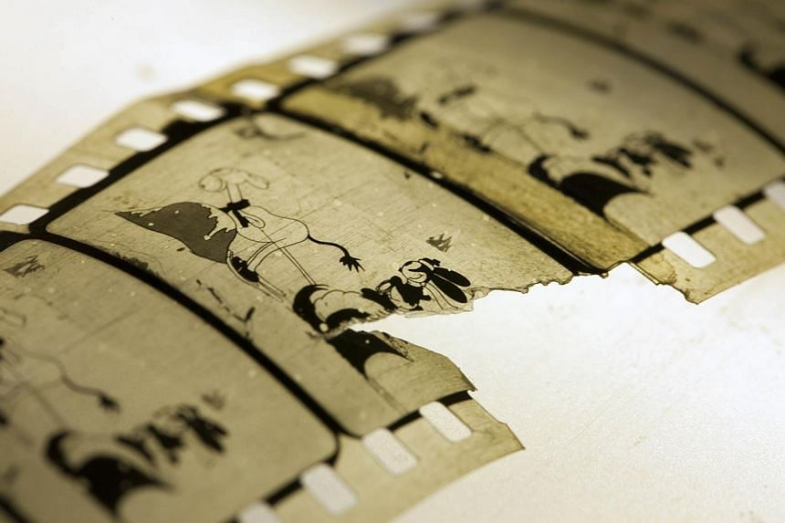 A handout photo released on Dec 11, 2014 by the National Library of Norway shows a restored copy of the animated short film dated 1927 Empty Socks from Walt Disney Christmas series Oswald the Lucky Rabbit. The film presumed lost has been found in the