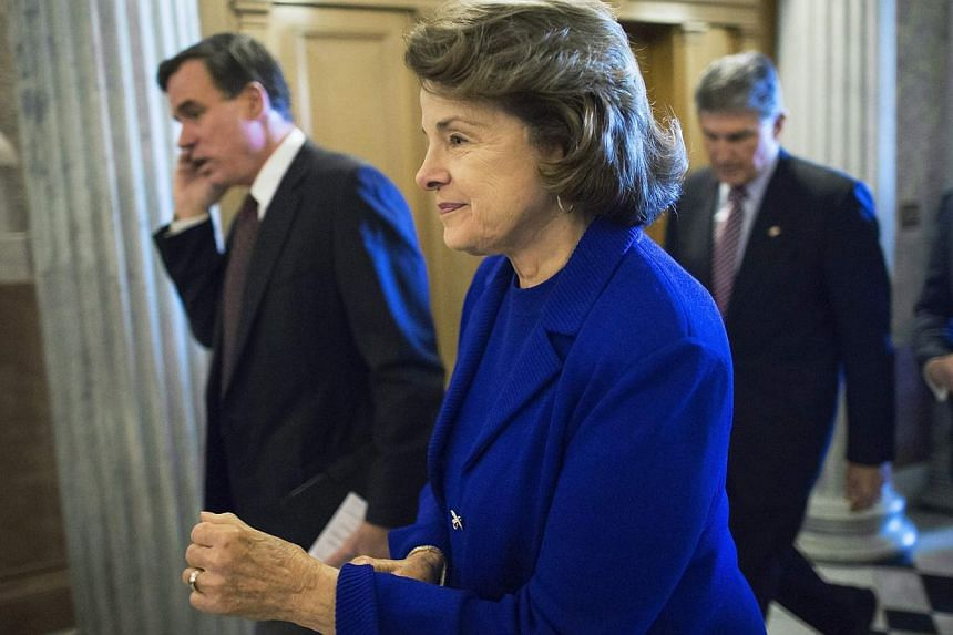 US Senator Dianne Feinstein (centre) at the US Capitol in Washington Dec 11, 2014. As CIA chief John Brennan defended the spy agency's interrogation programme for terror suspects Thursday, Ms Feinstein - whose committee published a damning report on