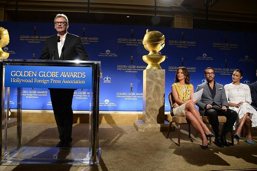 Hollywood Foreign Press Association president Theo Kingma (left) speaking at the 2015 Golden Globe Awards nominations announcement on Dec 11, 2014, at the Beverly Hilton Hotel, in Beverly Hills, California. Also on stage are (from left) actors Kate B