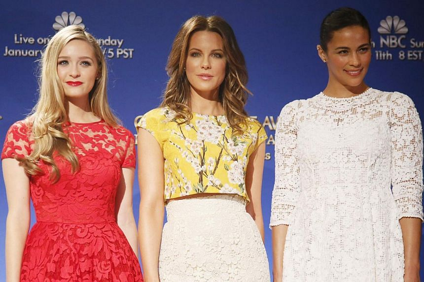 Actresses Kate Beckinsale, Paula Patton (right) and Miss Golden Globe Greer Grammer (left) posing at the nomination announcements for the 72nd annual Golden Globe Awards in Beverly Hills, California on Dec 11, 2014. -- PHOTO: REUTERS