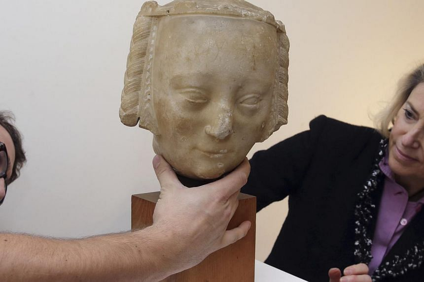 A 600-year-old marble head (above), believed to be from a sculpture of French queen Jeanne de Bourbon, wife of Charles V, was auctioned off for €1.15 million (S$1.8 million) in Paris on Thursday. -- PHOTO: REUTERS