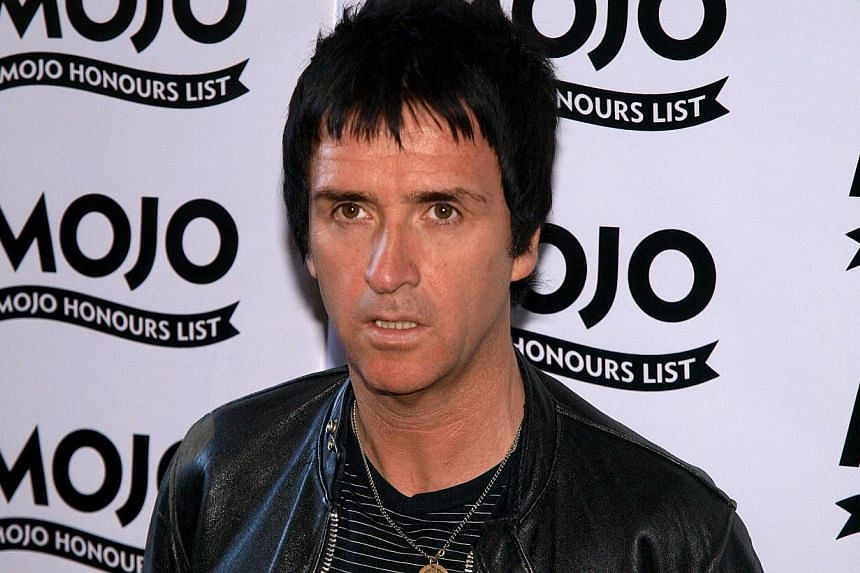 Guitarist Johnny Marr, whose intricate guitar work helped shape rock music from the post-punk era in the 1980s, scrapped a concert on Monday night in Seattle along with nine other West Coast dates. -- PHOTO: AFP