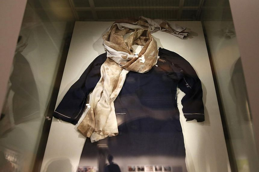 The blood-soaked school uniform belonging to Nobel Laureate Malala Yousafzai is displayed at the Nobel Peace Centre in Oslo on Dec 9, 2014. -- PHOTO: REUTERS