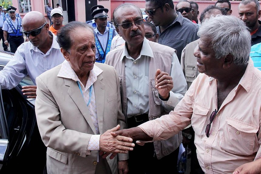 The outgoing prime minister of Mauritius accepted defeat Thursday in parliamentary polls, with power on the island nation now expected to transfer to opposition leader and ex-president Anerood Jugnauth, seen here (above left) greeting a supporter on