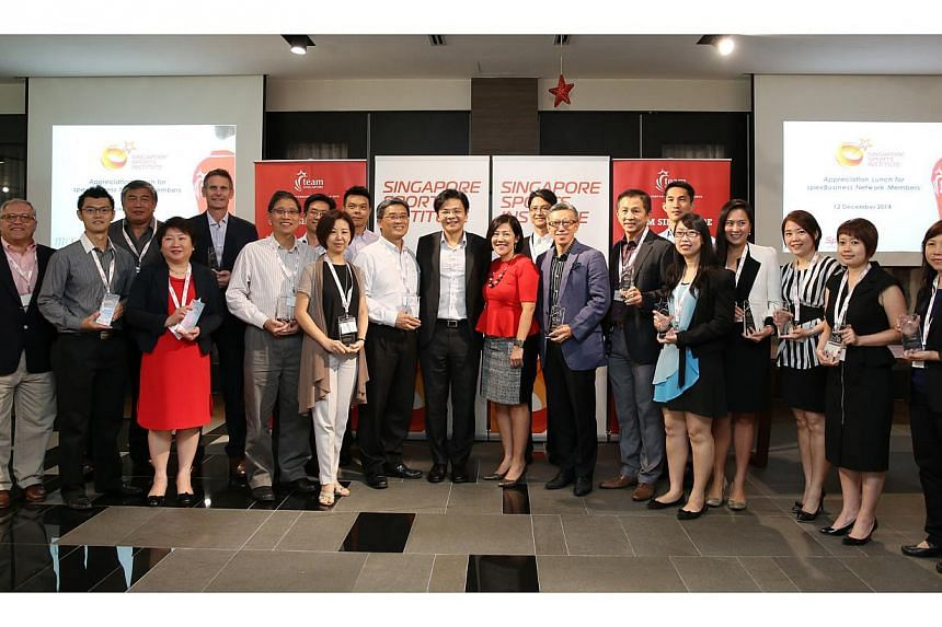 Minister Lawrence Wong with representatives from each of the 20 corporate partners in the spexBusiness Network for Athletes. Sport Singapore has unveiled seven more partnering corporations in its Sports Excellence Business (spexBusiness) Network for