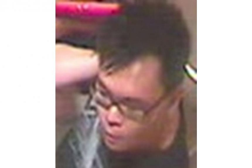 The man in question is believed to be of medium build with short black hair, as pictured.-- PHOTO: SINGAPORE POLICE FORCE