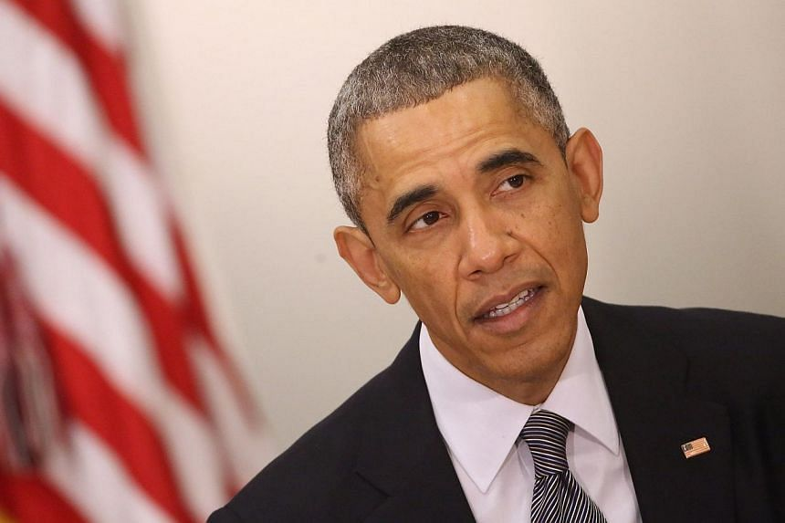 President Barack Obama (above) expressed caution on Thursday about the possibility of the United States adding more sanctions against Russia for its incursion into Ukraine because it could cause divide Washington and Europe. -- PHOTO: AFP