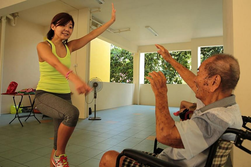 Ms Jacqueline Tan, founder of the Get Movin' for Charity, with an elderly resident at Thye Hua Kwan Seniors Activity Centre in Bukit Merah. -- PHOTO: KOH SOON SNG FOR GET MOVIN' FOR CHARITY