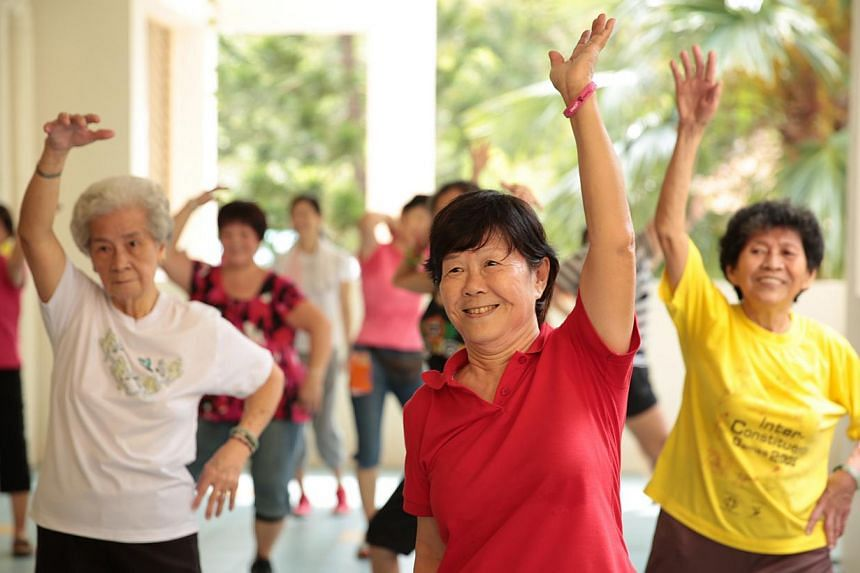 Elderly residents at Thye Hua Kwan Seniors Activity Centre in Bukit Merah practise zumba moves during a session of the Get Movin' for Charity zumba programme. -- PHOTO: KOH SOON SNG FOR GET MOVIN' FOR CHARITY