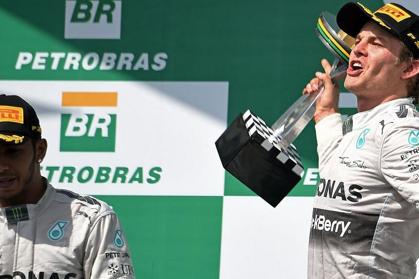 Driver Nico Rosberg (right) of Germany celebrates first place next to team-mate Lewis Hamilton (left) on the podium of the Brazilian Formula One Grand Prix on Nov 9, 2014. Formula One team principals have snubbed Mercedes driver Nico Rosberg in a bes