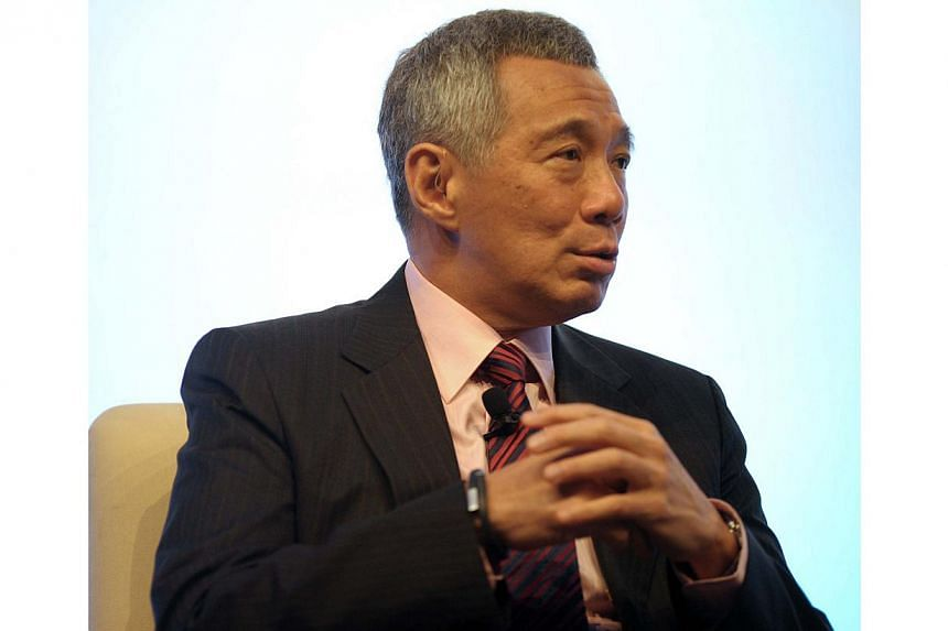 """Singapore's next General Election (GE) may not take place """"when everybody is expecting it"""", said Prime Minister Lee Hsien Loong on Friday. -- PHOTO: AFP"""